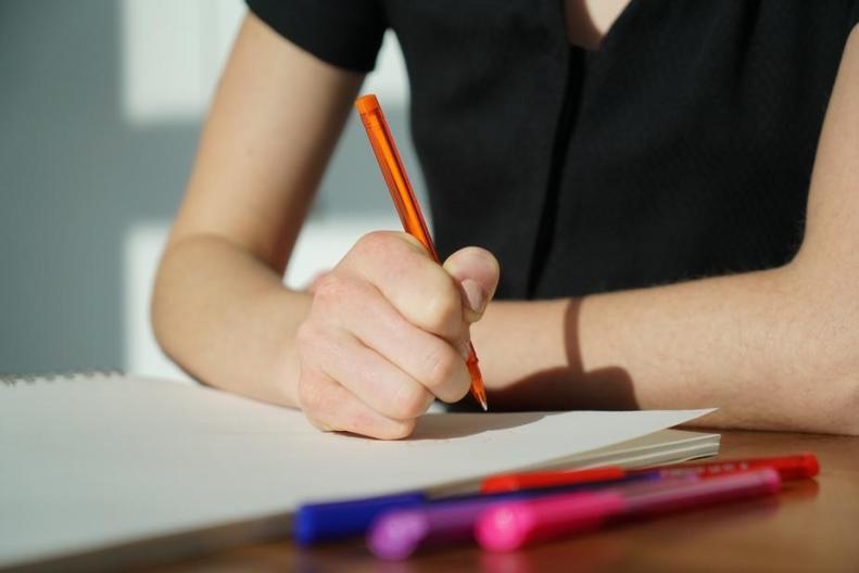 student-writing-on-paper_925x.jpg