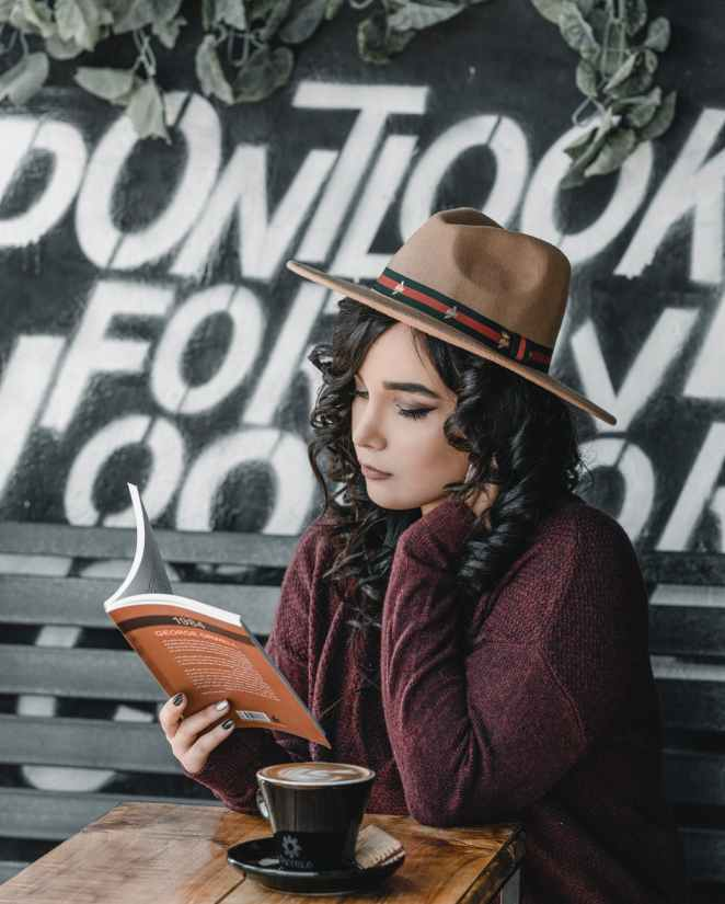 photo of woman holding book